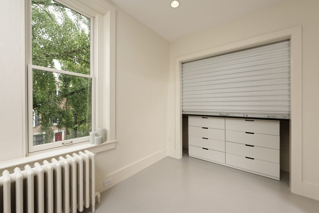 BOWA design build row home renovation in Washington, DC Baby Room Closet with Rolling Door