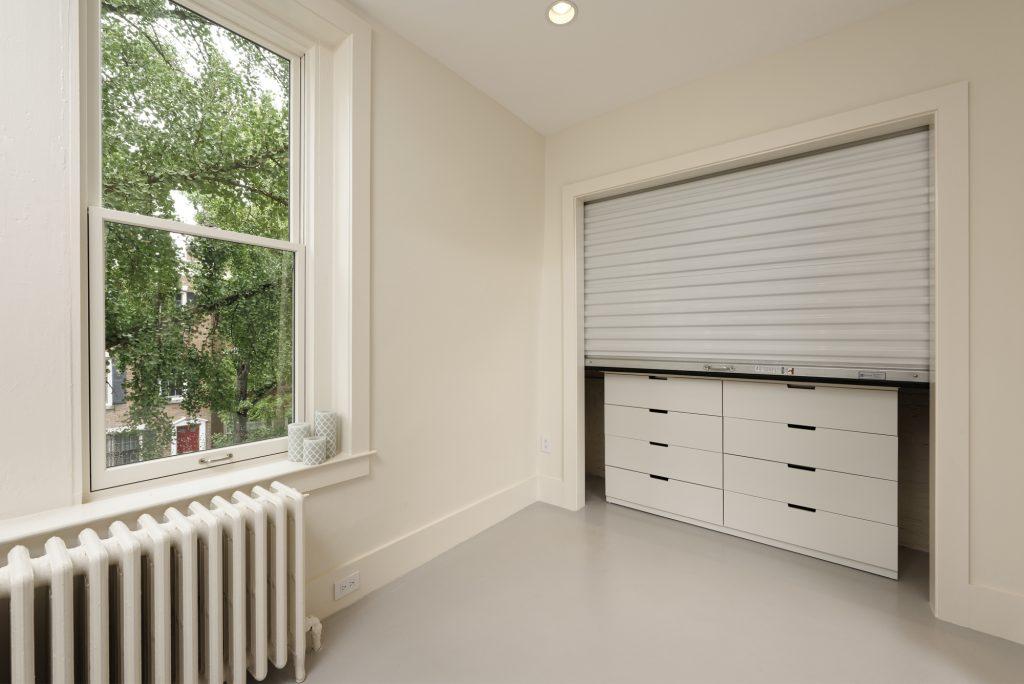 BOWA design build row home renovation in Washington, DC Baby Room Closet with Rolling Door
