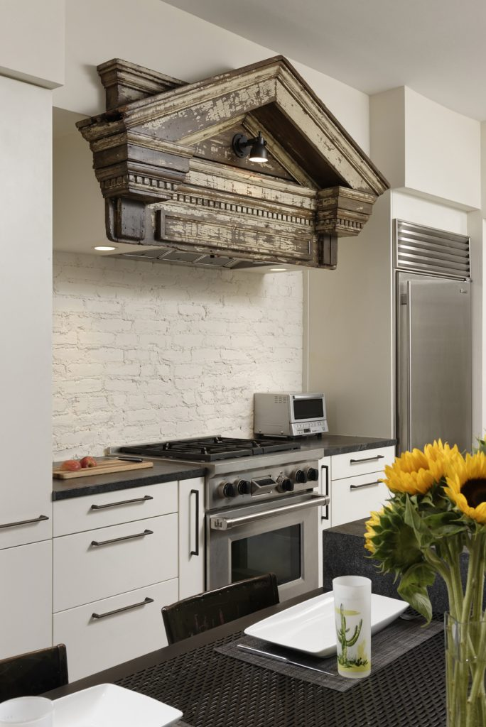 BOWA design build row home renovation in Washington, DC Stove hood detail industrial kitchen
