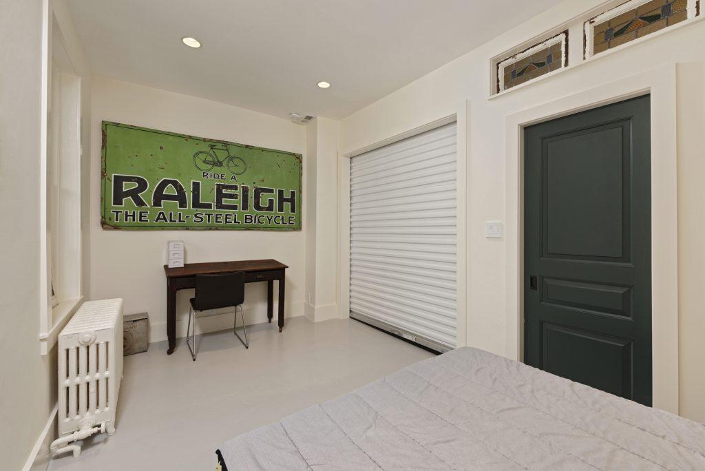 BOWA design build row home renovation in Washington, DC Guest Bedroom with Rolling Door