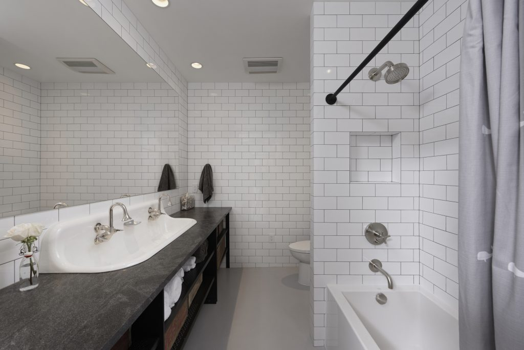 BOWA design build row home renovation in Washington, DC Guest Bathroom with Subway Tile