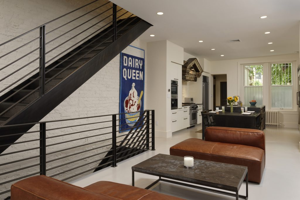 BOWA design build row home renovation in Washington, DC Industrial kitchen with metal staircase