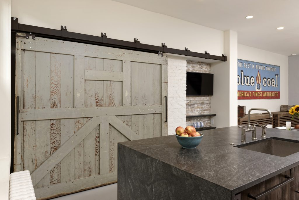 BOWA design build row home renovation in Washington, DC industrial kitchen Sliding Door Pantry