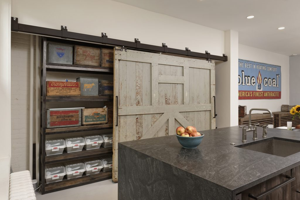 BOWA design build row home renovation in Washington, DC industrial kitchen with barn door pantry
