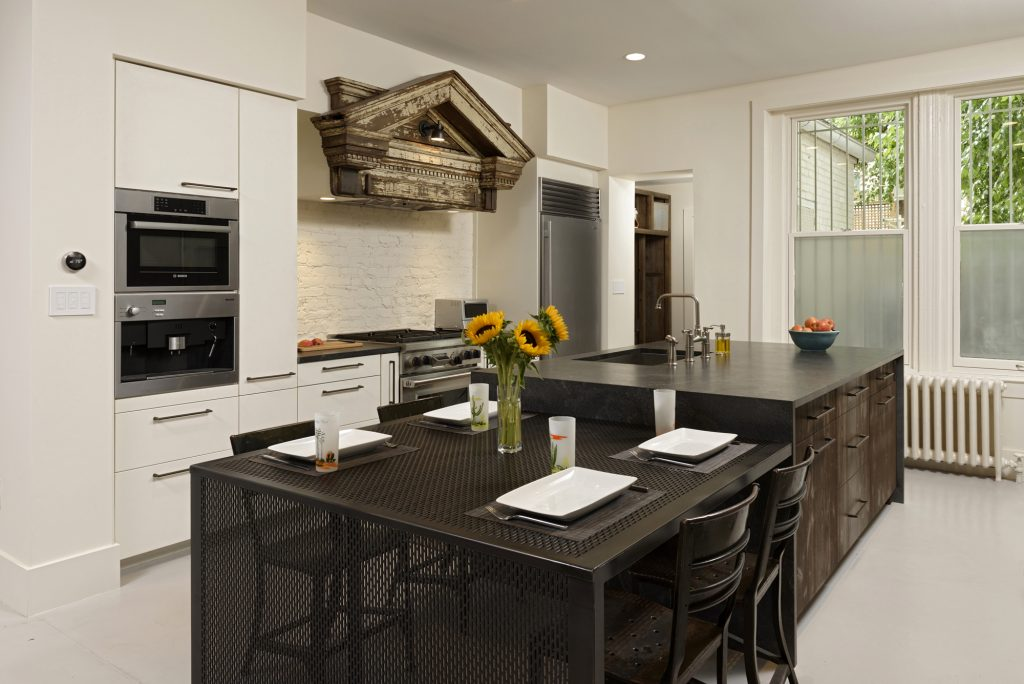 BOWA design build row home renovation in Washington, DC Industrial kitchen with custom table
