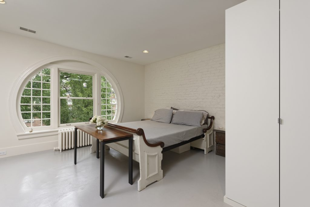 BOWA design build row home renovation in Washington, DC Master Bedroom with Round Window