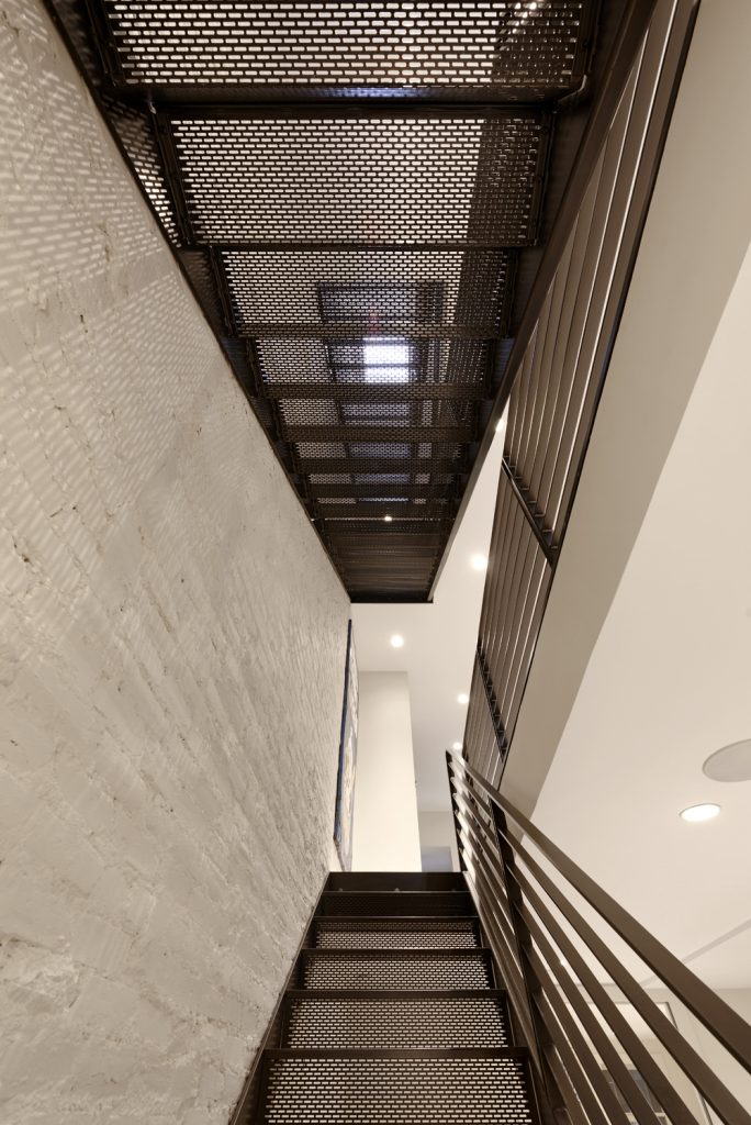 BOWA design build row home renovation in Washington, DC Two-Story Metal Staircase Industrial