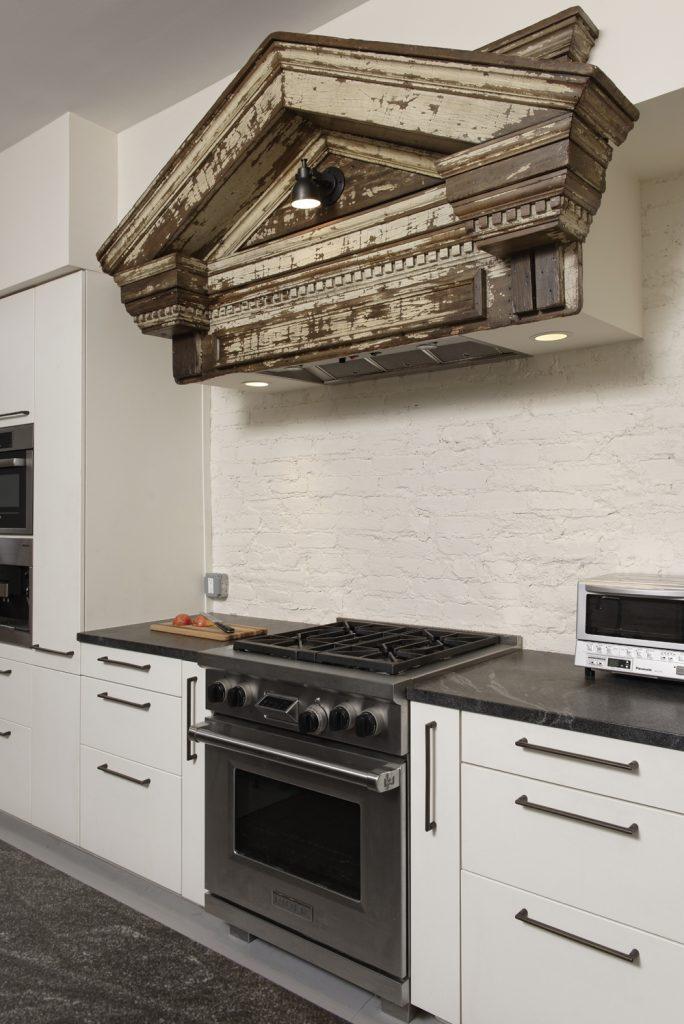 BOWA design build row home renovation in Washington, DC industrial kitchen stove hood