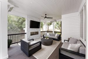 outdoor renovation featuring a screened in porch with fireplace